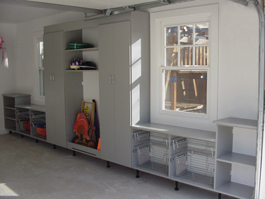 Cabinets and shelves extend closet space - even in a garage.