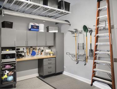 Cabinets and wall racks aid garage organization.