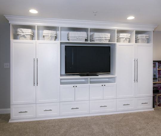 Non-traditional storage for off-season clothing and other items is a good option when there's limited space.